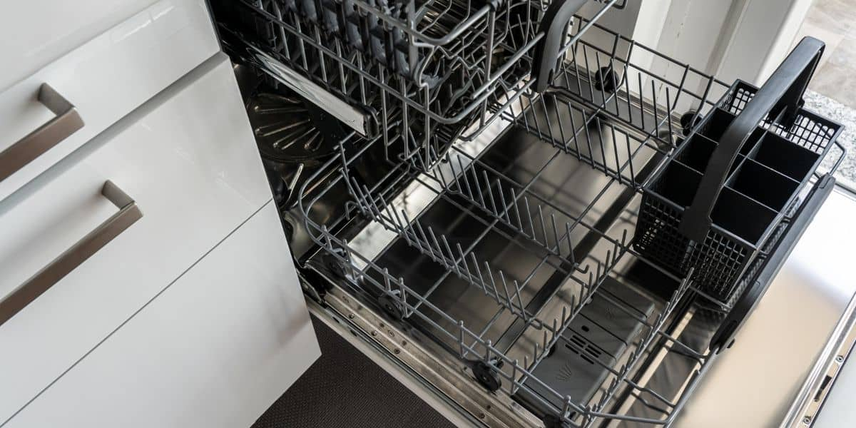 how far should a dishwasher stick out from the cabinet