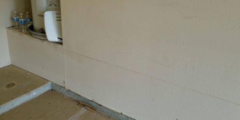 wet drywall near shower