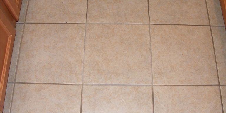 how to fix uneven grout lines